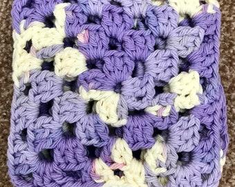 Set of 4 granny square coasters/doilies. Purple granny squares