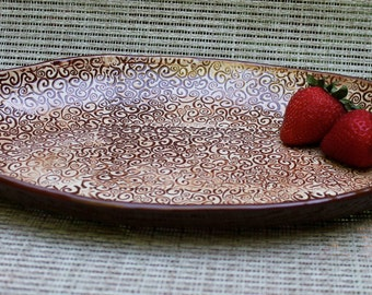 Brown and White Embossed Oval Porcelain Plate