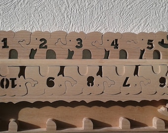 Puzzle in wood and toy to learn to count one through ten