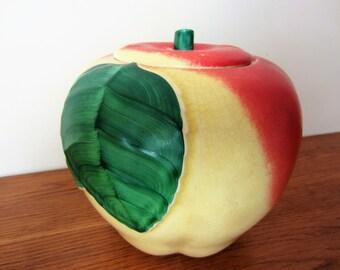 A vintage apple cookie jar.  Yellow green red apple vintage ceramic cookie jar canister.