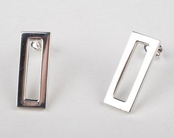 Sterling silver rectangle stud earrings.