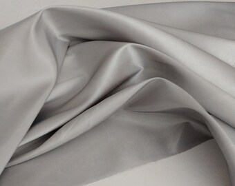 """Silver grey Platinum Taffeta  58-60"""" wide by yard. Shipping  5.00 first yard all others 1.00. Free swatches available upon request"""
