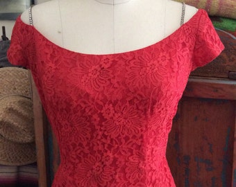 Red hot 1950s rhinestone detailed bombshell wiggle dress.