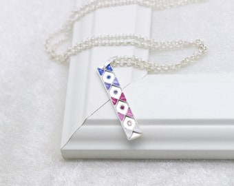 Silver pendant with enamel and zirconia