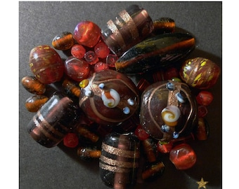 Indian Red, amber, violet of various shapes glass beads