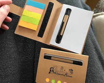 Travel sized notebook, with pen and sticky notes