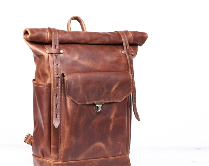 Roll top leather backpack in cognac brown colour.  Hipster backpack for laptop.