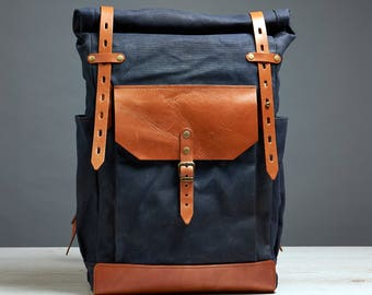 Roll top waxed canvas and leather backpack. Navy blue and brown bag. Hipster backpack.