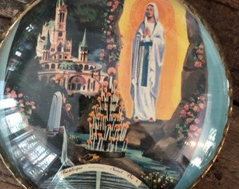 Antique French religious medallion with a scene from Lourdes, France showing the Virgin Mary's appearance