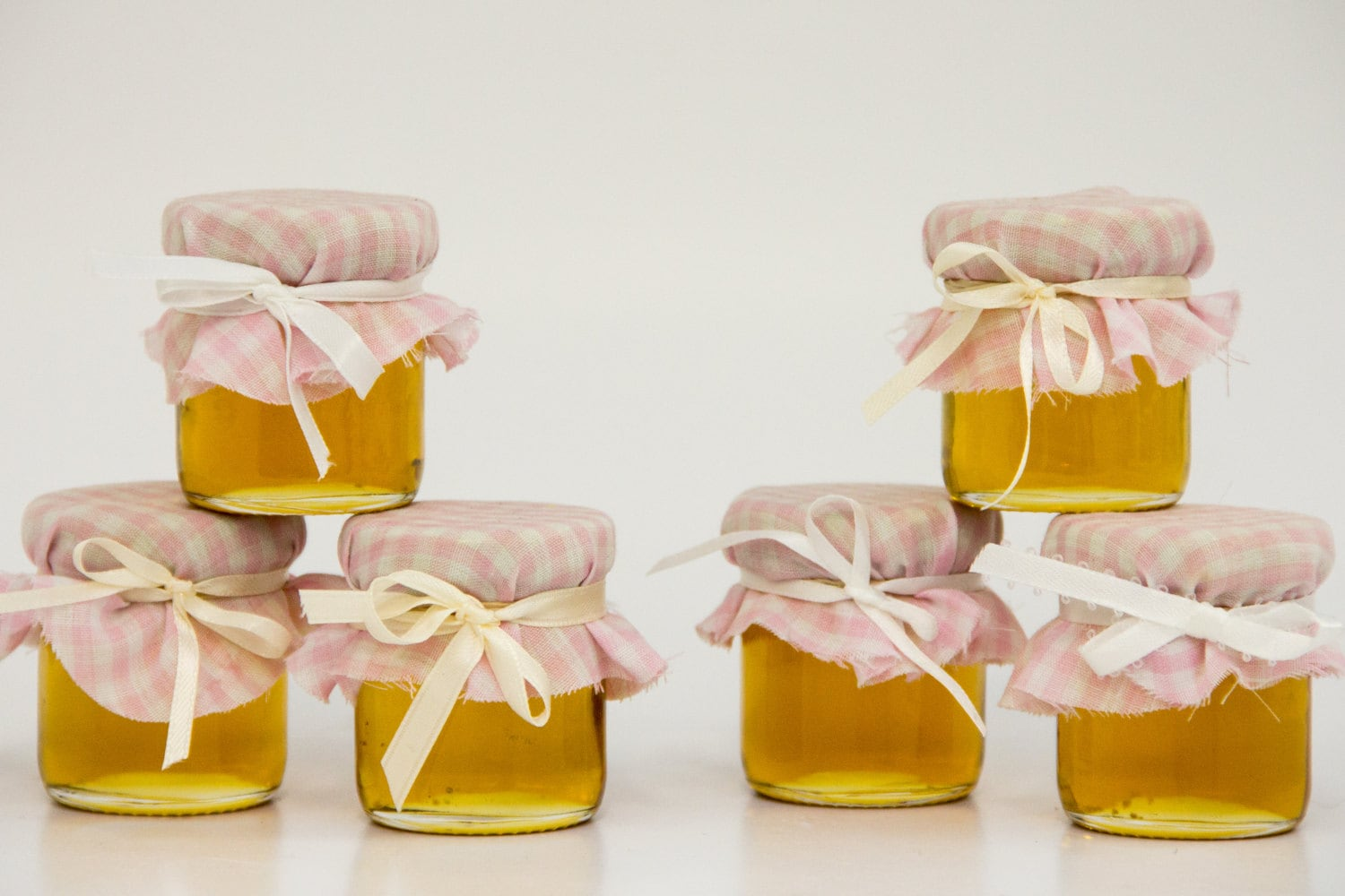 30 mini 2 oz. mason honey jars with pink gingham fabric that