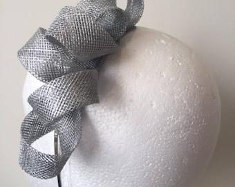 Silver sinamay loop fascinator on a metal headband. Gorgeous on!