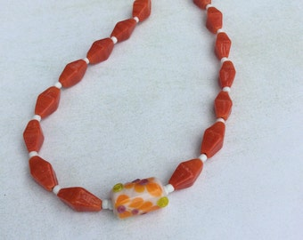 Orange glass diamond necklace. Lamp work orange,lime, purple glass focal.