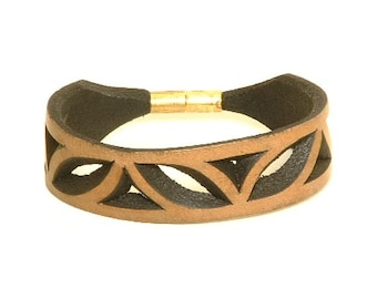 Carved leather bracelet with brass clasp
