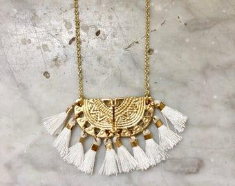 Necklace ALMA - golden brass - white pompoms - Marie de la Louise