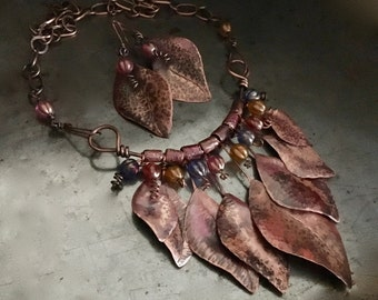 Statement necklace and earrings set, hand forged rustic metal leaf design, Czech glass