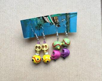 2 rainbow skull earrings