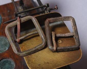 Set of 2 Antique similar solid brass belt buckles. Primitive finding.