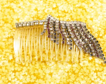 Vintage hair comb - clear plastic studded with clear, red, and black round glass rhinestones in silver-toned metal settings