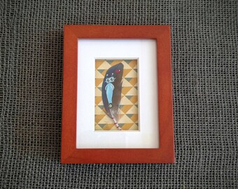 Mini Blue Robot with Heart Painting on Small Parrot Feather. Framed in Wood Frame with Printed Geometric and White Matting. Original Art.