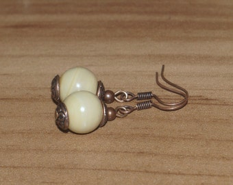 Copper earrings with beige glass beads