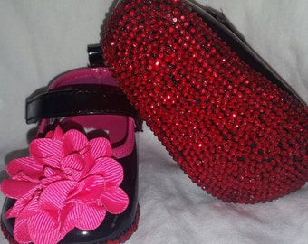 Red bottom baby girl shoes (size 2)