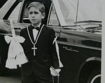 Vintage Communion.Photography Black and white.Catholic.Classic car.Falcon.Religious.Crucufix.Catolico.Crucifijo.Church.Vintage boy.Iglesia.