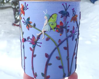 Tiny Luna moth Fairy in her Multi Colored Garden Sculpted with Polymer Clay onto a Recycled Glass Candle Holder in Periwinkle blue