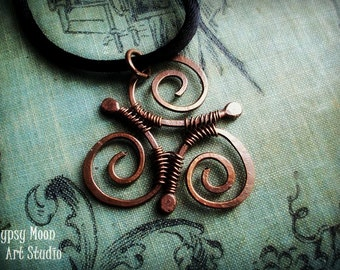 Celtic Triskele- copper wire wrapped pendant