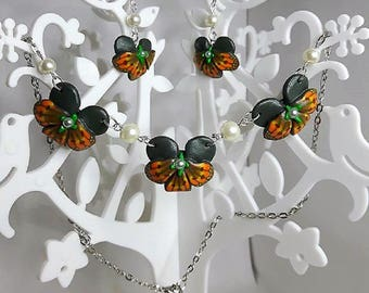 Orange orchids set made with polymer clay.