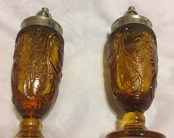 Amber glass salt and pepper shakers 1960s depression glass style from Hong Kong