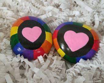 One rainbow ringed heart painted rock