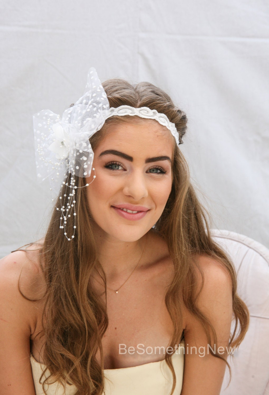 white wedding elastic headband with dotted veil bow flower