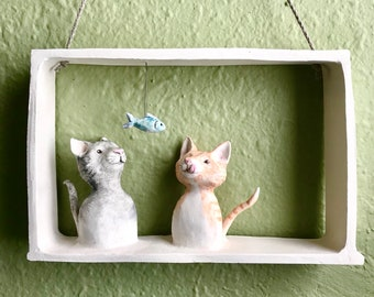 temptation - two cats and a fish ceramic wall hanging