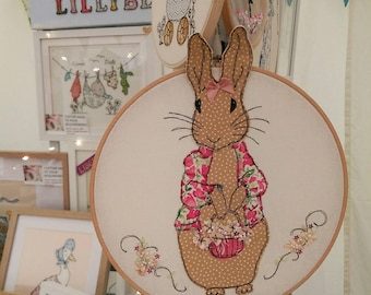 Rosie Rabbit freehand machine embroidery framed on a hoop with a ribbon hanging bow. 3D ears and flowers. Nursery babyshower