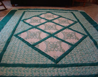 queen-king size quilt- hand embroidered blocks- machine put together and machine quilted-104 by 94 inches