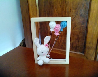 Amigurimi rabbit and his balloons. Handmade crochet made by hand.