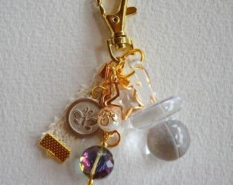 Keychain, handbag, theme lollipop baby, and beads