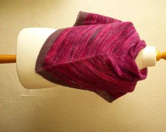 Triangular handspun and handknitted woollen shawl in deep shades of pink and purple