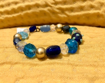 SJC10300 - Handmade blue, gold and clear glass and crystal beaded bracelet with gold-color clasp