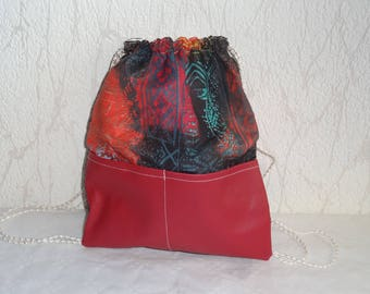 Back fabric and faux leather handbag