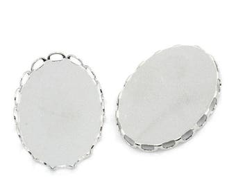 A set of two scalloped oval cabochon size 18 x 25 mm.