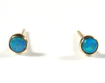 3mm cabochon lab Opal ,gold studs.
