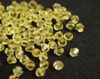 25 BICONES 4 mm Crystal yellow N38