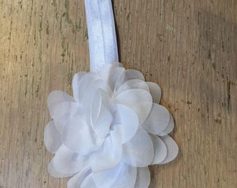 Baby headband with flower in white.