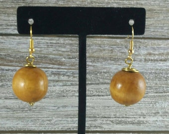 Light brown wooden round earrings