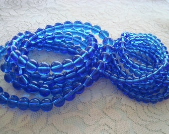 """6mm & 8mm Medium Cobalt Blue Rounds. Smooth Rounds in Translucent Royal Blue. Imitation Druk Beads. Full 16"""" Strands. Saturated Color."""