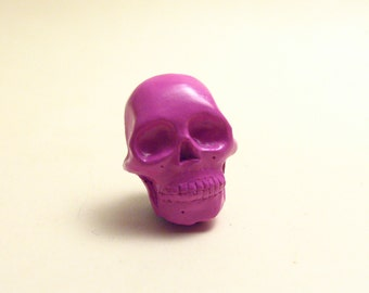 Tiny pink Skull lapel pin
