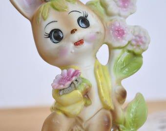 Ceramic figurine of bunny with flowers