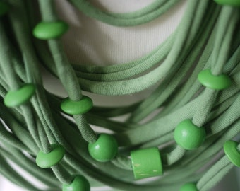 Upcycled t-shirt scarf: Soft green with wooden beads [369]
