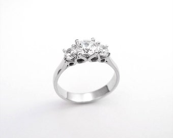 Curved three stone engagement ring